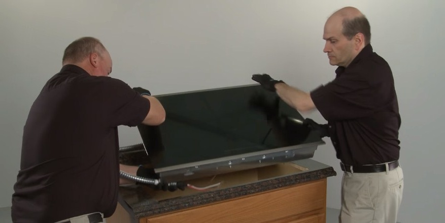 Two best men for installing electric cooktop