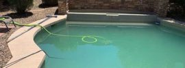 Cleaning pool with garden hose